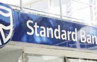 Standard Bank cuts foreign currency fees