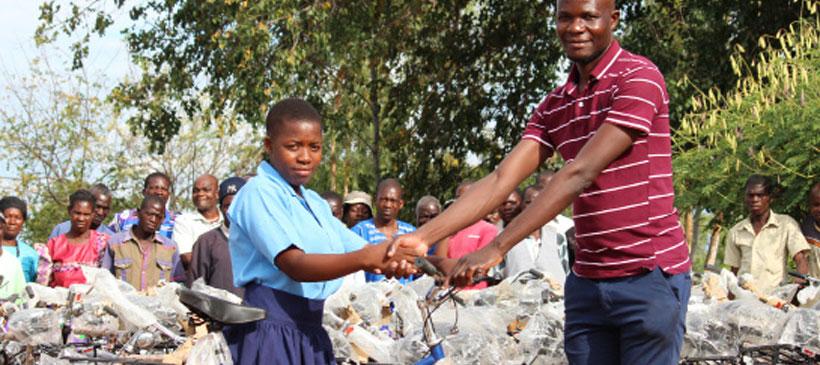 Oxfam, Cavwoc distribute bicycles