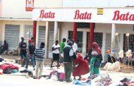 Business slow as Malawians vote